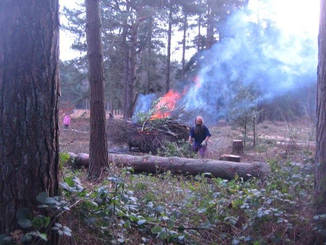 Tibor tending bonfire