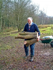 Geoffrey Moore carrying logs